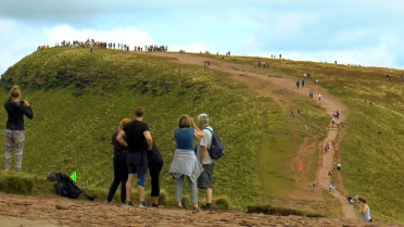 Many people on Pen Y Fan as taken from Corn Du
